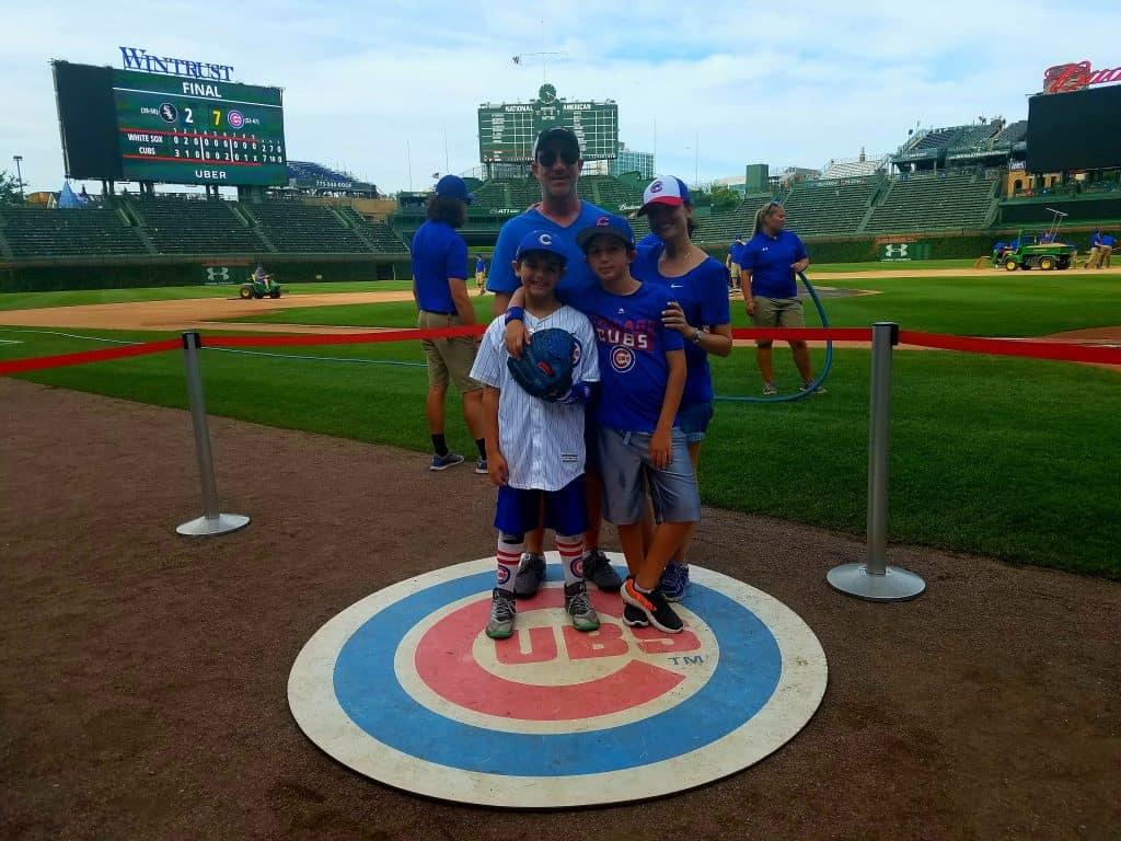 Wrigley Field Chicago Family Vacation Family Photo on Field