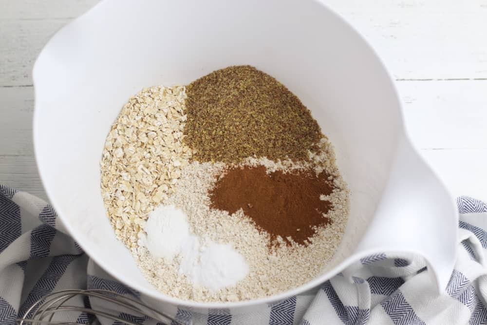 dry ingredients for gluten free peanut butter banana oat muffins with chocolate chips