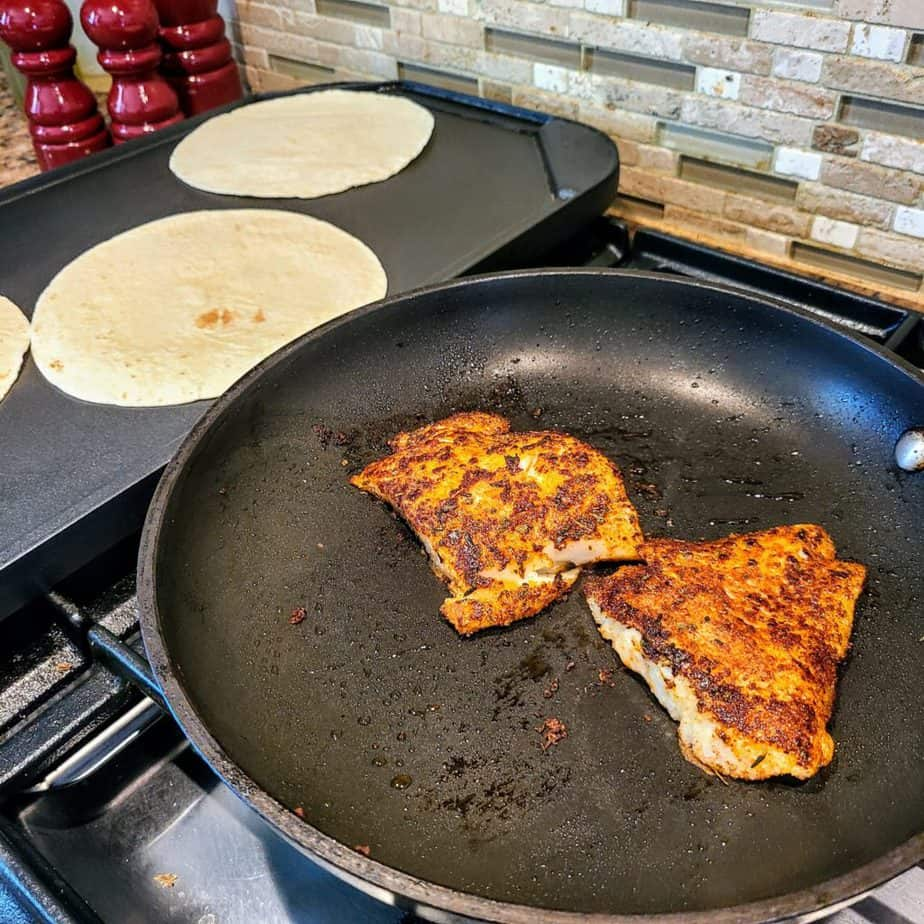 Fish Taco Recipe cooking fish and warming tortillas